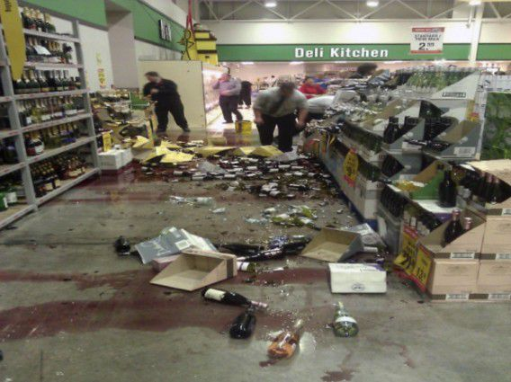 Staff at a supermarket in the Christchurch clean up smashed wine bottles after an earthquake struck December 23, 2011. An earthquake of 5.8 magnitude struck near the New Zealand city of Christchurch on Friday, New Zealand's civil defence said, prompting the evacuation of some public buildings and sending goods toppling from shelves. REUTERS/Nathan Mercer (NEW ZEALAND - Tags: DISASTER ENVIRONMENT) NO SALES. NO ARCHIVES. FOR EDITORIAL USE ONLY. NOT FOR SALE FOR MARKETING OR ADVERTISING CAMPAIGNS