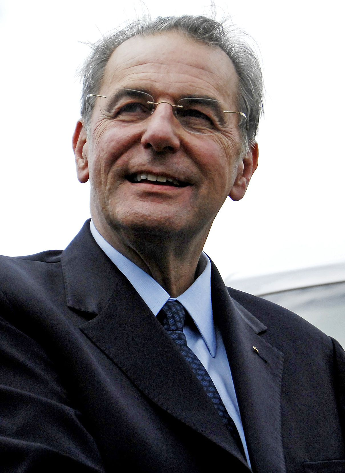 Jacques Rogge. Foto AP Belgium's Jacques Rogge, President of the International Olympic Committee (IOC), smiles during a visit to Warren, Barbados, Tuesday, March 18, 2008. Rogge is visiting several Caribbean islands. (AP Photo/Chris Brandis)