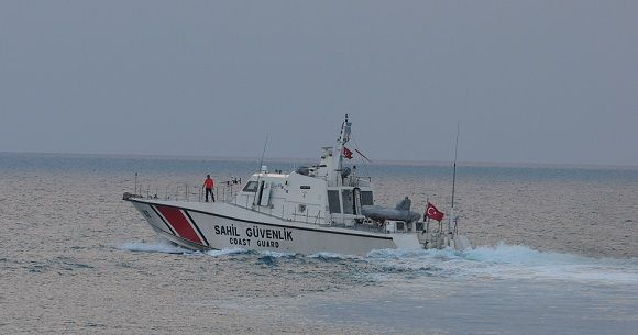 """Caption: Turkish coast guard searches for the Turkish warplane which was downed by Syria on Friday off Samandagi in Hatay province in the eastern Mediterranean, Sunday, June 24, 2012. Turkey would seek the meeting over article 4 of the NATO charter concerning Friday's incident. The article says member countries """"will consult together whenever, in the opinion of any of them, the territorial integrity, political independence or security of any of the parties is threatened."""" (AP Photo)"""