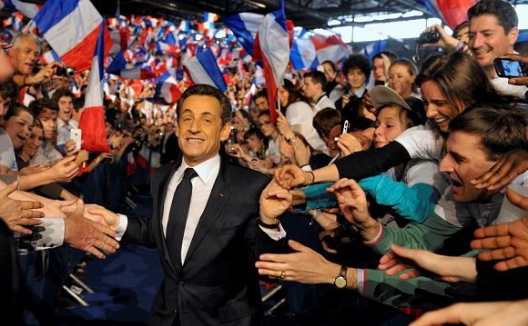 Caption: France's President and UMP party candidate for the 2012 French presidential elections Nicolas Sarkozy is cheered by supporters as he arrives at a political rally in Villepinte, Paris suburb March 11, 2012. REUTERS/Philippe Wojazer (FRANCE - Tags: POLITICS ELECTIONS)