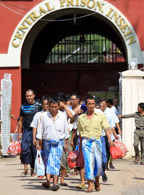 Myanmar prisoners walk outside Insein Prison in Yangon, Myanmar Wednesday, Oct. 12, 2011 .Myanmar has begun releasing more then 6,300 prisoners but has held back on freeing some prominent political prisoners. The releases began around the country Wednesday morning after President Thein Sein issued an amnesty for 6,359 prisoners a day earlier. (AP Photo/Khin Maung Win)