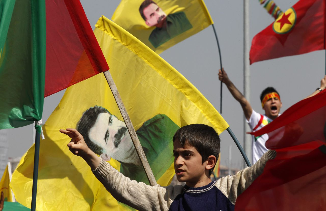 Demonstrators hold Kurdish flags and flags with portraits of jailed Kurdistan Workers Party (PKK) leader Abdullah Ocalan during a gathering to celebrate Newroz in the southeastern Turkish city of Diyarbakir March 21, 2013. Ocalan ordered his fighters on Thursday to cease fire and withdraw from Turkish soil as a step to ending a conflict that has killed 40,000 people, riven the country and battered its economy. Hundreds of thousands of Kurds, gathered in the regional centre of Diyarbakir, cheered and waved banners bearing Ocalan's moustachioed image when a letter from the rebel leader, held since 1999 on a prison island in the Marmara Sea, was read out by a pro-Kurdish politician. REUTERS/Umit Bektas (TURKEY - Tags: POLITICS CIVIL UNREST)