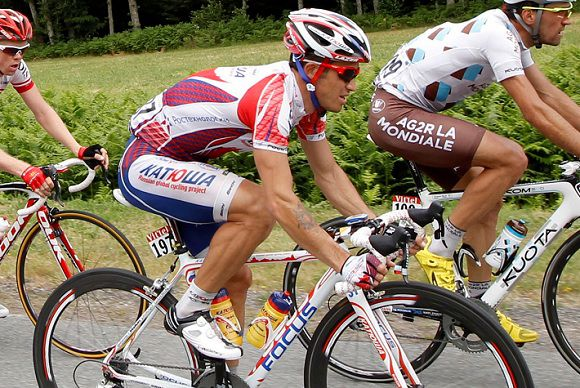 Caption: Katusha rider Alexandr Kolobnev of Russia cycles during the eighth stage of the Tour de France 2011 cycling race from Aigurande to Super-Besse in this file photo taken July 8, 2011. Kolobnev has failed a doping test during the Tour de France, an official with direct knowledge of the situation told Reuters on Monday. Picture taken July 8, 2011. REUTERS/Stefano Rellandini (FRANCE - Tags: SPORT CYCLING CRIME LAW)