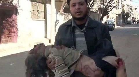 """GRAPHIC CONTENT An image grab taken from a video uploaded on YouTube on February 5, 2012 shows a Syrian man holding a girl who activists said was killed in the Baba Amr neighbourhood when shells were fired by regime forces in the flashpoint Syrian city of Homs. Outrage grew after Russia and China blocked a UN Security Council resolution condemning Syria for its crackdown on protests, with the opposition saying it handed the regime a """"licence to kill."""" AFP PHOTO/YOUTUBE == RESTRICTED TO EDITORIAL USE - MANDATORY CREDIT """"AFP PHOTO / YOUTUBE"""" - NO MARKETING NO ADVERTISING CAMPAIGNS - DISTRIBUTED AS A SERVICE TO CLIENTS - AFP IS USING PICTURES FROM ALTERNATIVE SOURCES AS IT WAS NOT AUTHORISED TO COVER THIS EVENT, THEREFORE IT IS NOT RESPONSIBLE FOR ANY DIGITAL ALTERATIONS TO THE PICTURE'S EDITORIAL CONTENT, DATE AND LOCATION WHICH CANNOT BE INDEPENDENTLY VERIFIED =="""