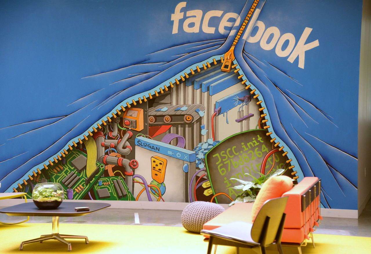 A mural decorates one of the many open space work areas at the Facebook headquarters in Menlo Park, California, May 15, 2012. Facebook, the world's most popular internet social network, expects to raise USD 12.1 billion in what will be Silicon Valley's largest-ever initial public offering (IPO) later this week. AFP PHOTO / ROBYN BECK