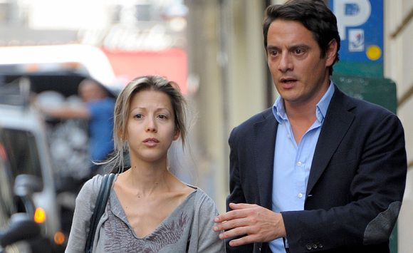 Caption: Writer Tristane Banon walks with her lawyer David Koubbi as they leave his office in Paris July 5, 2011. Former IMF chief Dominique Strauss-Kahn inched closer on Tuesday to having U.S. sex assault charges against him dropped although a complaint of assault in France could pose a further hurdle to any political comeback. A legal complaint by French writer Banon, who alleges Strauss-Kahn tried to assault her in Paris in 2003, was to be filed later on Tuesday, her lawyer told Reuters. REUTERS/Philippe Wojazer (FRANCE - Tags: CRIME LAW POLITICS)