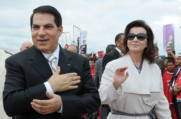 (FILES) A file photo taken on October 11, 2009 shows then-Tunisian President Zine El Abidine Ben Ali (L) and his wife Leila during the presidential election campaign at the Rades stadium near Tunis. Leila Trabelsi, who goes on trial in absentia on June 20, 2011 with her deposed husband Zine El Abidine Ben Ali, was a secretary and hairdresser before becoming Tunisia's most powerful -- and maybe hated -- woman. Widely despised for years before a popular uprising that drove the former first couple from the presidential palace at Carthage, Trabelsi and her family were able to lay their hands on entire sections of the Tunisian economy. AFP PHOTO/ FETHI BELAID