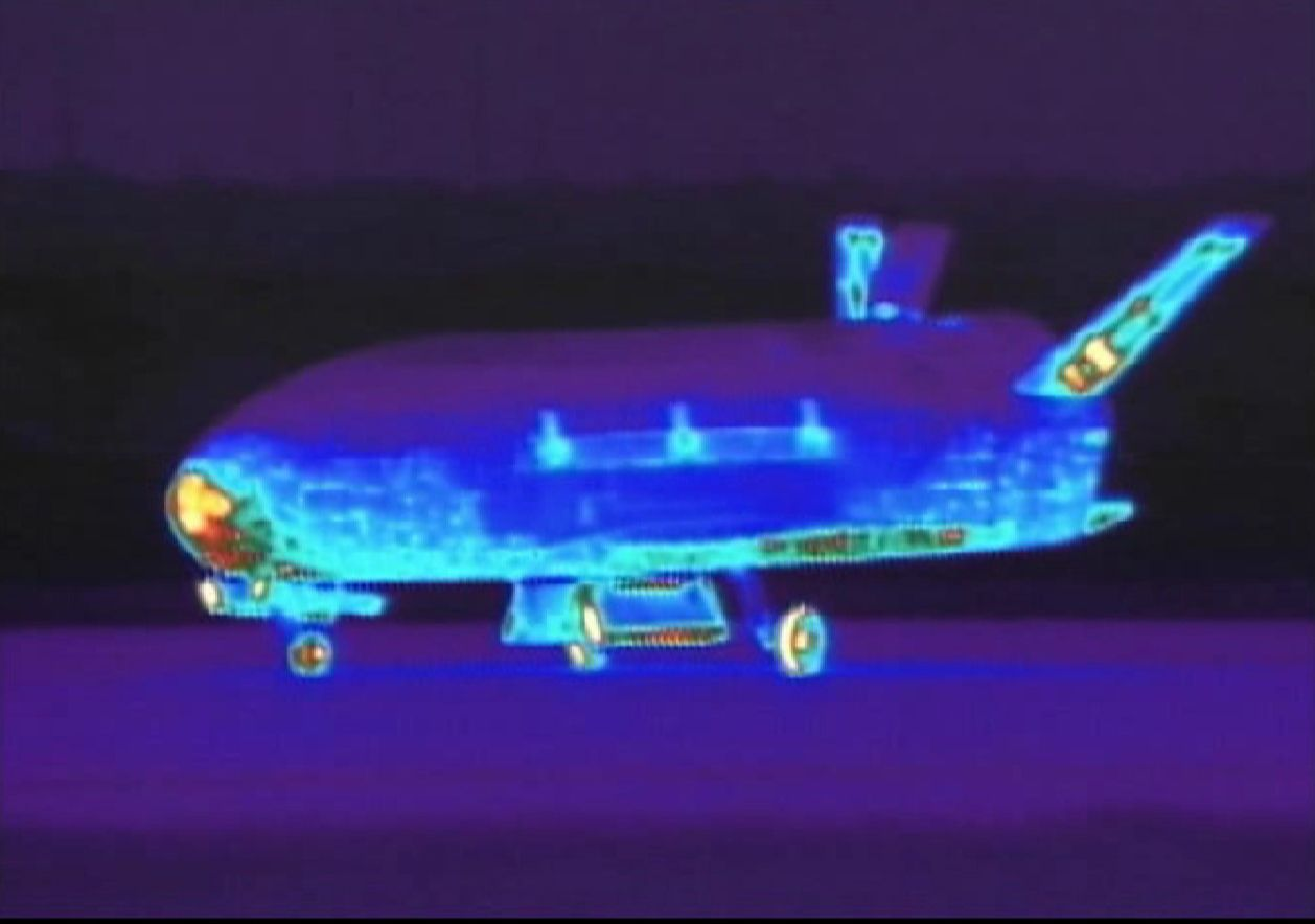The U.S. military's unmanned X-37B robotic space shuttle lands after returning from orbit, from a secretive 15-month test flight, in California in this still image taken from infrared video shot on June 16, 2012. The miniature space plane, also known as Orbital Test Vehicle-2, or OTV-2, touched down at California's Vandenberg Air Force Base, 130 miles (209 kilometers) northwest of Los Angeles. The X-37B due to fly this fall is the vehicle that inaugurated the program in 2010. REUTERS/30th Space Wing Public Affairs/Handout (UNITED STATES - Tags: SCIENCE TECHNOLOGY MILITARY) NO SALES. NO ARCHIVES. FOR EDITORIAL USE ONLY. NOT FOR SALE FOR MARKETING OR ADVERTISING CAMPAIGNS. THIS IMAGE HAS BEEN SUPPLIED BY A THIRD PARTY. IT IS DISTRIBUTED, EXACTLY AS RECEIVED BY REUTERS, AS A SERVICE TO CLIENTS