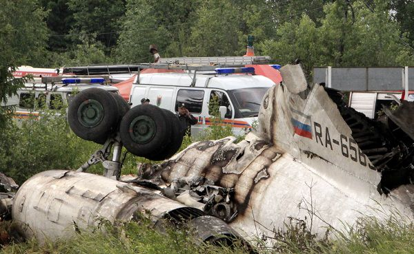Emergency Ministry cars seen near a wreckage of Tu-134 plane, belonging to the RusAir airline, near the city of Petrozavodsk Tuesday, June 21, 2011.The passenger jet crashed in heavy fog and burst into flames late Monday on a highway in northwestern Russia, just short of a runway whose fog lights had failed, killing 44 people, officials said. Eight people survived the crash.(AP Photo/Timur Khanov, Komsomolskaya Pravda) RUSSIA OUT