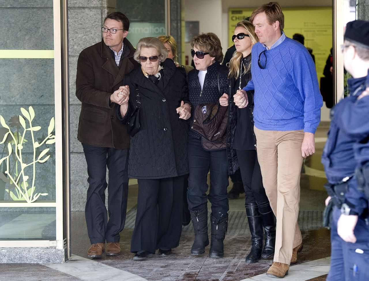 Dutch Prince Constantijn, Queen Beatrix, her sister Margriet Van Vollenhoven, wife of Prince Johan Friso Princess Mabel and Prince Willem Alexander leave the main hospital in Innsbruck, western Austria, Friday, Feb 24, 2012, one week after the Queen's second son Prince Johan Friso was rushed to the intensive care unit of the clinic after he was buried by an avalanche. Doctors treating the Dutch Prince say he suffered massive brain damage and he may never regain consciousness. (AP Photo/Kerstin Joensson)