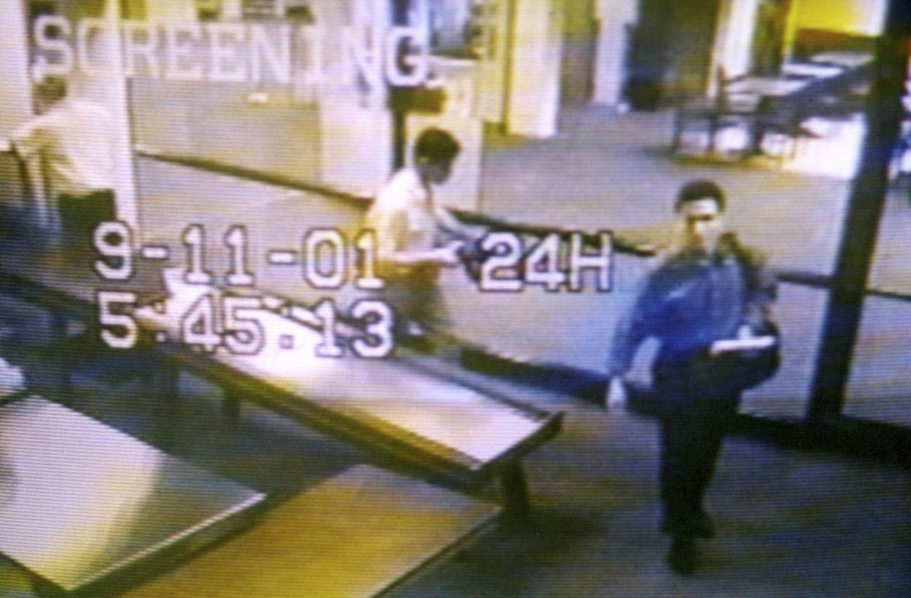 """ATTENTION EDITORS - THIS FILE PICTURE IS ONE OF 83 TO ACCOMPANY THE TENTH ANNIVERSARY OF THE SEPTEMBER 11 ATTACKS. SEARCH FOR KEYWORD """"9/11"""" TO SEE ALL THE IMAGES (PXP901-PXP983) A still image taken from a surveillance camera shows two men identified by authorities as suspected hijackers Mohammed Atta (R) and Abdulaziz Alomari (C) passing through airport security at Portland International Jetport in Maine on September 11, 2001. September 11th marks the 10th anniversary of the 9/11 attacks where nearly 3,000 people died when four hijacked airliners were used in coordinated strikes on the Pentagon and the World Trade Center towers. The fourth plane crashed in Pennsylvania. REUTERS/Portland Police Department/Handout/Files (UNITED STATES - Tags: CRIME DISASTER ANNIVERSARY) FOR EDITORIAL USE ONLY. NOT FOR SALE FOR MARKETING OR ADVERTISING CAMPAIGNS"""