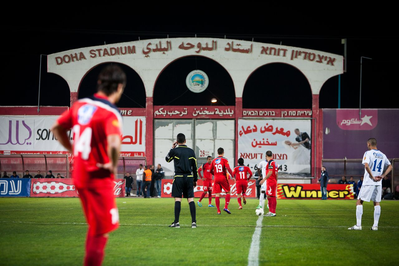SAKHNIN, ISRAEL DECEMBER 10: Israeli Arab, Ihoud Bnei Sakhnin football team play vast Hapoel Ashdod at their home Doha Stadium on December 10, 2011 in Sakhnin, Israel. Bnei Sakhnin, with Israeli Arab, Israeli Jews and foreign players, is the most successful Israeli Arab club, they have won the State Cup in 2004. (Photo by Yoray Liberman)