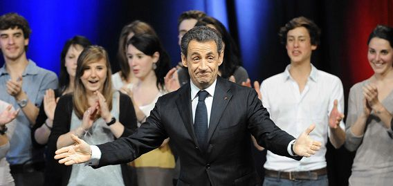 Caption: France's incumbent president and Union for a Popular Movement (UMP) party candidate for the French 2012 presidential election Nicolas Sarkozy arrives on stage to deliver a speech during a campaign meeting on April 29, 2012 in the southwestern city of Toulouse. The latest opinion poll published on Sunday by the LH2 institute for web portal Yahoo! forecast that Hollande would comfortably win the May 6 run-off by 54 percent of the vote to Sarkozy's 46, with the gap narrowing. AFP PHOTO / PASCAL PAVANI
