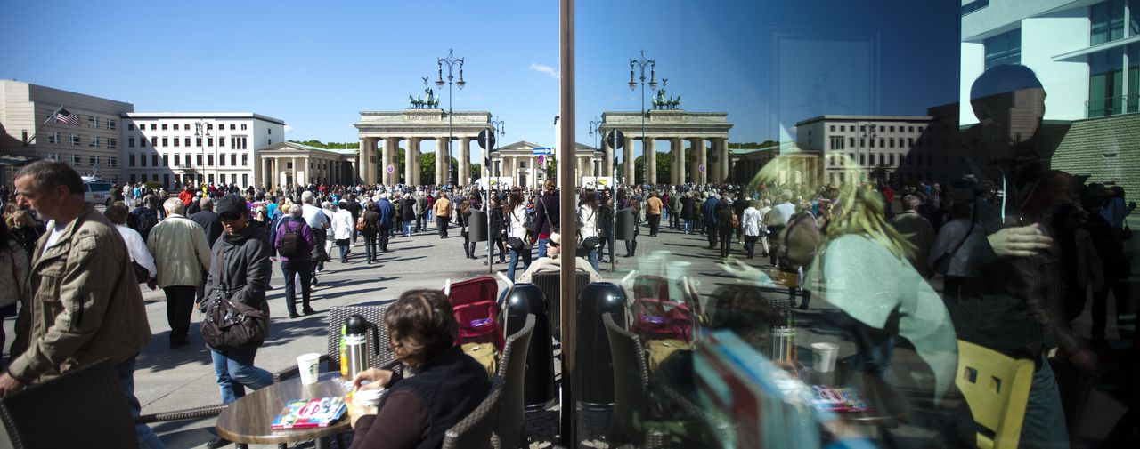 Tourists stand at the Pariser Platz in front of the U.S. embassy and next to the Brandenburg Gate in Berlin Tuesday, May 3, 2011. The security in Germany's capital is still at a high level and not special raised after the killing of Osama bin Laden, the mastermind behind the Sept. 11, 2001, in an operation led by the United States. (AP Photo/Markus Schreiber)