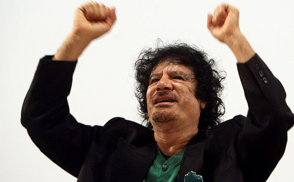 Caption: Libyan leader Muammar Gaddafi delivers a speech at the Paris UNESCO headquarters in this December 11, 2007 file photo. Gaddafi died of wounds suffered on October 20, 2011 as fighters battling to complete an eight-month-old uprising against his rule overran his hometown Sirte, Libya's interim rulers said. His killing, which came swiftly after his capture near Sirte, is the most dramatic single development in the Arab Spring revolts that have unseated rulers in Egypt and Tunisia and threatened the grip on power of the leaders of Syria and Yemen. REUTERS/Jacky Naegelen/Files (FRANCE - Tags: POLITICS)