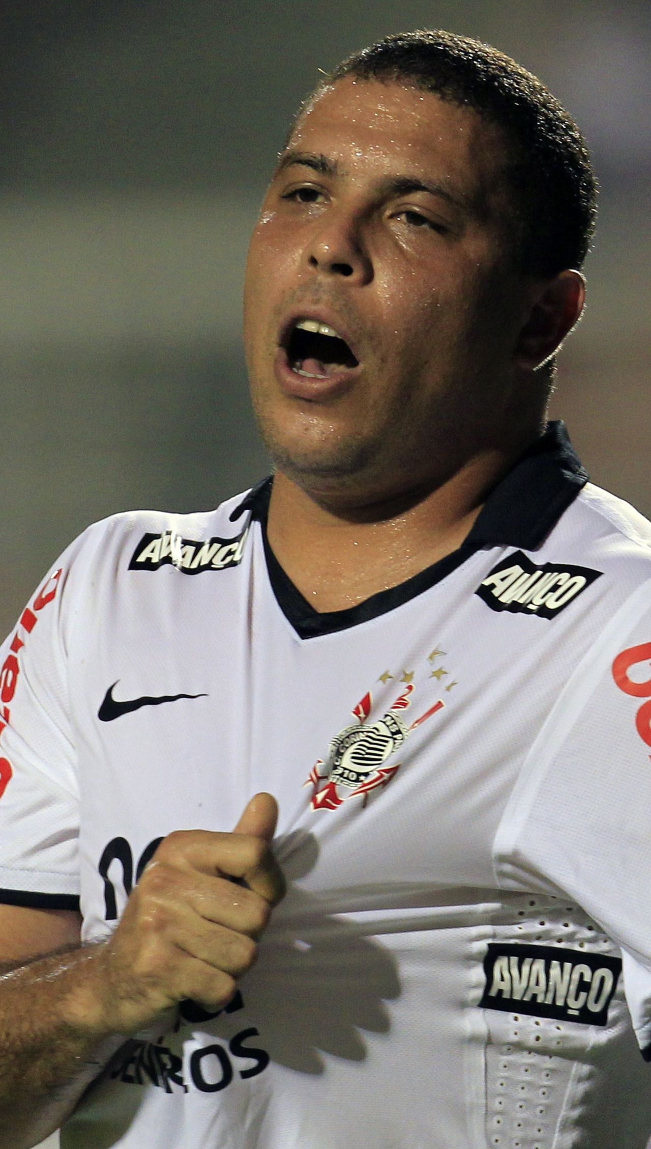 Ronaldo of Brazil's Corinthians reacts during their Copa Libertadores soccer match against Colombia's Deportes Tolima in Sao Paulo in this January 26, 2011 file photo. Former Brazil striker Ronaldo will announce his retirement from soccer on February 14, 2011, he told Brazilian newspaper Estado de Sao Paulo on February 13, 2011. The 34-year-old three-time world player of the year has a contract with Corinthians until the end of 2011 but is bringing his retirement forward after the team's shock early elimination from the Libertadores Cup and violent protests from fans. REUTERS/Paulo Whitaker/Files (BRAZIL - Tags: SPORT SOCCER)