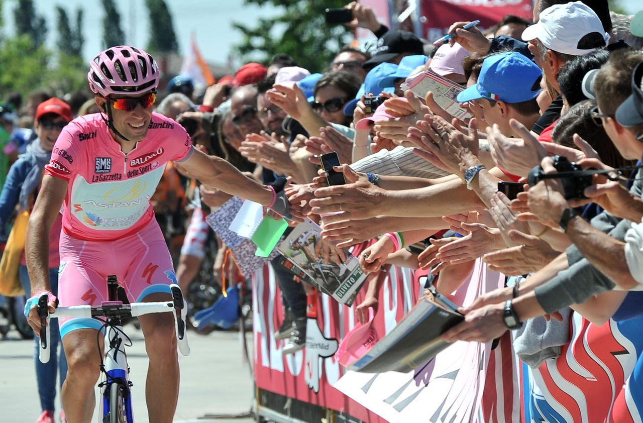 Vincenzo Nibali is cheered by supporters prior to start the 21st and last stage of the Giro d'Italia, Tour of Italy cycling race, in Riese Pio X, Sunday, May 26, 2013. Vincenzo Nibali virtually wrapped up the Giro d'Italia title with a dominating solo performance to win the penultimate stage Saturday, leaving behind his rivals under a blizzard of snow on the race's final climb. (AP Photo/Gian Mattia D'Alberto)