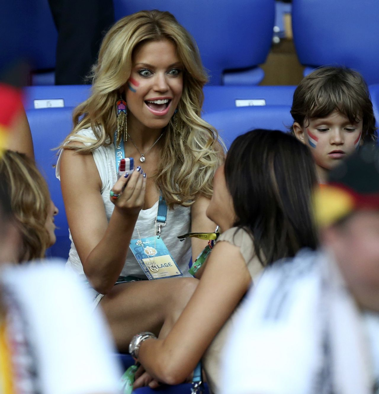 Netherlands' Rafael van der Vaart's wife Sylvie reacts before the Euro 2012 soccer match between Netherland and Germany in Kharkiv June 13, 2012. REUTERS/Thomas Bohlen (POLAND - Tags: SPORT SOCCER)