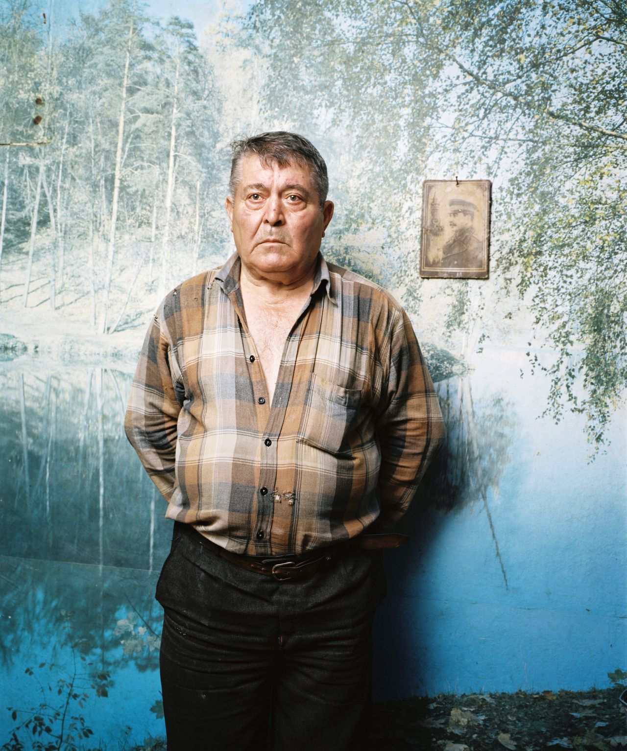 Khetakhurovo, SOUTH OSSETIA, 2011 - Zaur - a big fan of Stalin - is completely deperate as the back of his house is ruined by a shrapnel. He is to old to repair it, he doesn't have money and he is blaming the government of corruption, 'otherwise they would have repaired my house'.