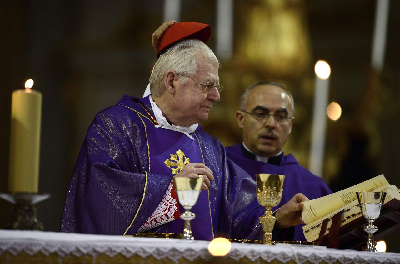 Cardinal Angelo Scola of Italy has his cardinal's cap removed as he gives mass at the Santi XII Apostoli (the Church of the Twelve Holy Apostles) in Rome March 10, 2013. REUTERS/Dylan Martinez (ITALY - Tags: RELIGION)