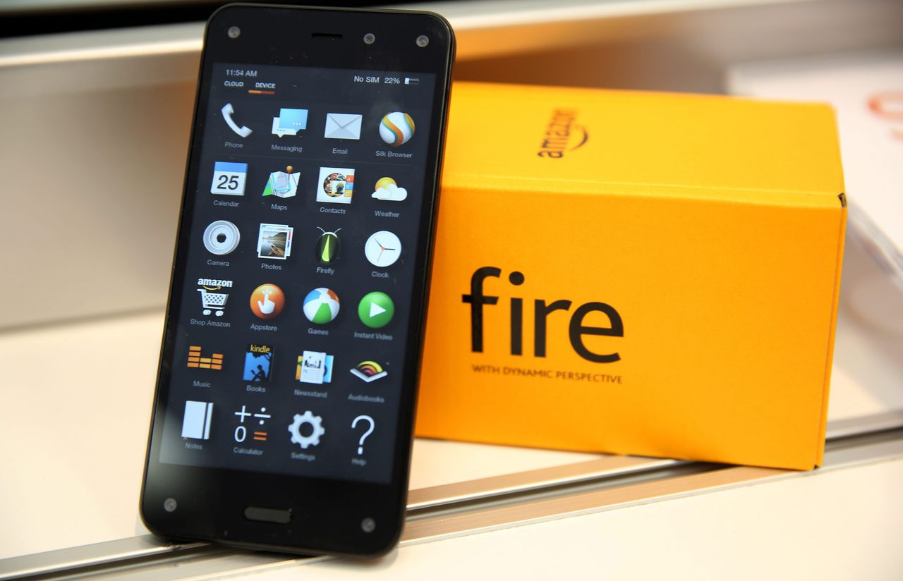 epa04330681 The new Amazon Fire Phone lies on display at an AT&T store in Brooklyn, New York, USA, 25 July 2014. Online retailer Amazon's own smartphone Fire Phone went on sale in the United States exclusively on AT&T. The so-called Fire Phone features a 4.7-inch screen, a 13-megapixel camera and optical image stabilization. EPA/ANDREW GOMBERT