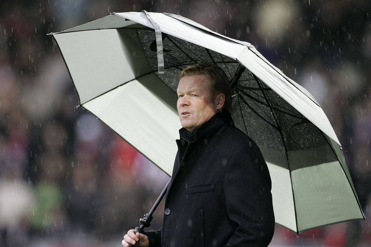 "PSV-trainer Ronald Koeman langs de lijn bij Sparta. Foto Pics United Onderwerp/Subject: PSV eredivisie Reklame: Club/Team/Country: Sparta Rotterdam - PSV Seizoen/Season: 2006/2007 FOTO/PHOTO: PSV's coach Ronald KOEMAN with umbrella Trefwoorden/Keywords: #03 $12 ±1167486123985 Photo- & Copyrights © PICS UNITED P.O. Box 1235 - 5602 BE EINDHOVEN (THE NETHERLANDS) Phone +31 (0)40 296 28 00 Fax +31 (0) 40 248 47 43 http://www.pics-united.com e-mail : info@pics-united.com (If you would like to raise any issues regarding any aspects of products / service of PICS UNITED) or e-mail : sales@pics-united.com ATTENTIE: Publicatie ook bij aanbieding door derden is slechts toegestaan na verkregen toestemming van Pics United. VOLLEDIGE NAAMSVERMELDING IS VERPLICHT! (© PICS UNITED/Naam Fotograaf, zie veld 4 van de bestandsinfo 'credits') ATTENTION: © Pics United. Reproduction/publication of this photo by any parties is only permitted after authorisation is sought and obtained from PICS UNITED- THE NETHERLANDS The image is copyright to PICS UNITED or its associate photographers. Full name must be printed with the photo! (© PICS UNITED/Name Photographer, see field 4 of the File Info, 'credits"") You may not publish, reproduce on either an electronic bulletin board, corporate intranet or the Internet, licence, sell or otherwise distribute the image(s) without a Licence to do so from PICS UNITED."