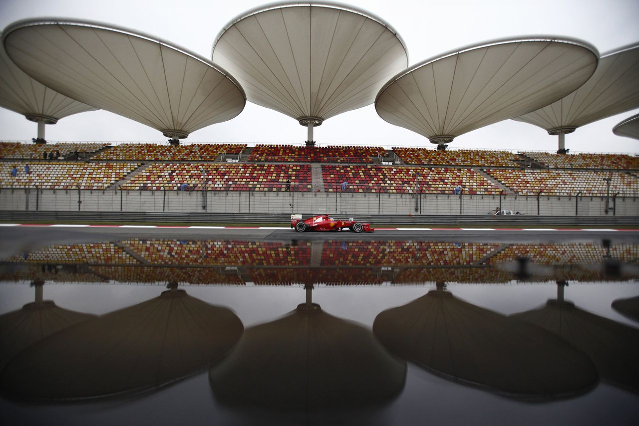 Ferrari Formula One driver Fernando Alonso of Spain drives during the first practice session of the Chinese F1 Grand Prix at Shanghai International circuit April 13, 2012. REUTERS/Carlos Barria (CHINA - Tags: SPORT MOTORSPORT TPX IMAGES OF THE DAY)