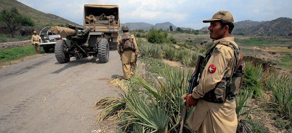Caption: A soldier keeps guard near a truck transporting ammunition to an army base camp in Tora Warai, a town in Kurram Agency, during a military trip organised for media along the Pakistan Afghanistan border July 10, 2011.The Pakistan Army said on July 4 that it had launched an air and ground offensive against militants in Kurram region on the Afghan border, its first major military operation since the May 2 killing of Osama bin Laden. Picture taken on July 10, 2011. REUTERS/Khuram Parvez (PAKISTAN - Tags: CIVIL UNREST CRIME LAW MILITARY)