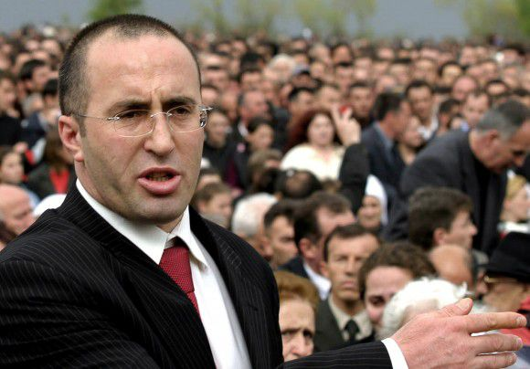 (FILES) A file picture taken on April 17, 2005 shows Former Kosovan prime minister Ramush Haradinaj provisionally freed by the UN war crimes tribunal, paying his last respect to his brother Enver who was killed by unknown attackers in an ambush on the road leading from the Western town of Pec to their home in Glogjane, a village 80 kilometers west of the provincial capital Pristina. Former Kosovo prime minister Ramush Haradinaj was back in court on August 18, 2011 on war crimes charges after appeal judges found witnesses were intimidated during his original 10-month trial. Haradinaj, 43, the most senior Kosovo leader to stand trial at the ICTY, is being retried with fellow ethnic Albanian Idriz Balaj, 39, on six counts of murder, cruel treatment and torture committed during Kosovo's 1998-99 war. AFP PHOTO/ ERMAL META