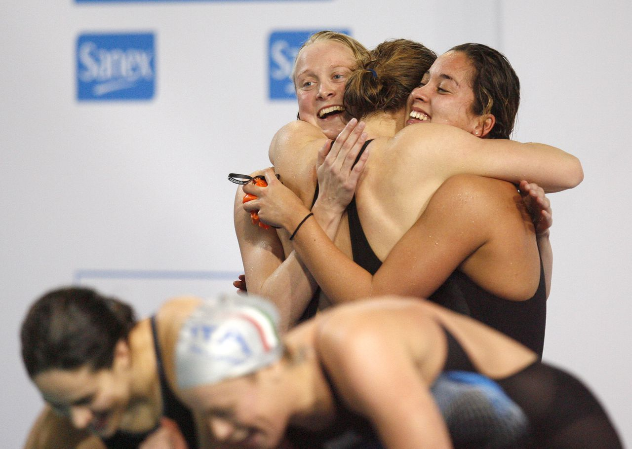 Members of the Dutch team celebrate after winning the gold medal in the Women's 4x100m freestyle relay final during the European Swimming Championships in Eindhoven, The Netherlands, Tuesday March 18, 2008. The won in a new world record time of 3:33.62.(AP Photo/Michael Sohn)