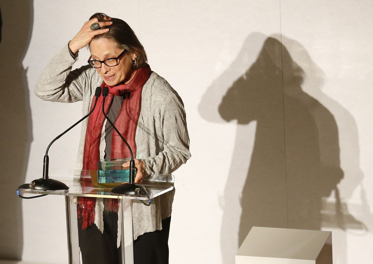 Lydia Davis of U.S. with the trophy makes a speech after winning the Man Booker International Prize at an award ceremony in London, Wednesday, May 22, 2013. The Man Booker International Prize is awarded every two years to a living author who has published fiction either originally in English or whose work is available in translation in the English language. (AP Photo/Sang Tan)