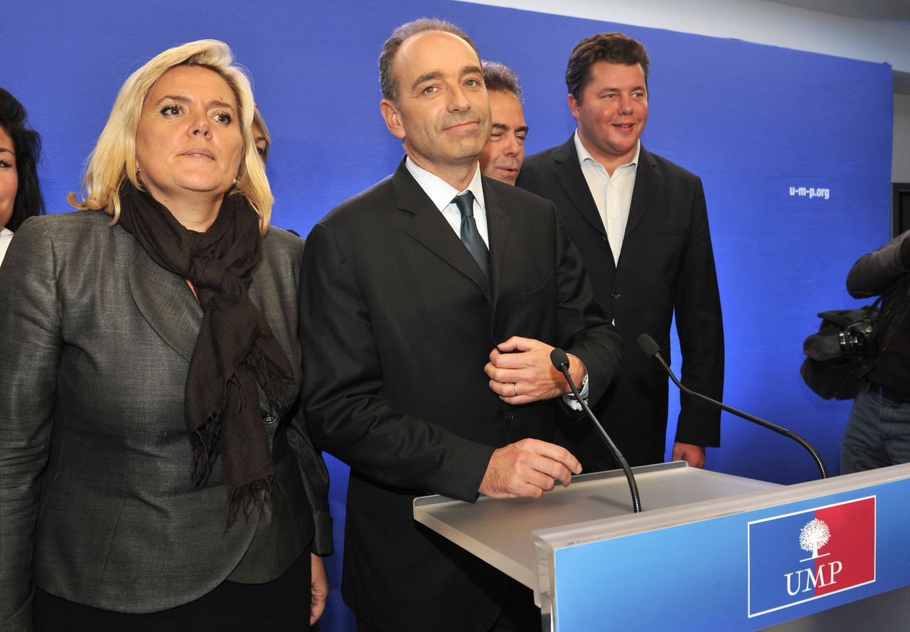 France's main centre-right opposition UMP party general secretary, Jean-Francois Cope (C) flanked by team campaign member, Michele Tabarot (L) and Luc Chatel (3rdL), speaks to the press after the announcement of his victory in a battle for the leadership of the opposition right-wing UMP party, on November 19, 2012 at the party's headquarters in Paris a day after the election. Jean-Francois Cope edged former prime minister Francois Fillon to succeed Nicolas Sarkozy as the leader of France's right-wing opposition UMP party after a bitterly contested election, the party's internal polling commission said today. Cope, the party's firebrand secretary-general, defeated Fillon by 98 votes, the head of the electoral commission said, a day after an election in which around 175,000 votes were cast. AFP PHOTO MEHDI FEDOUACH