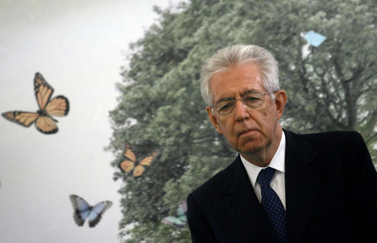 "Italian Prime Minister Mario Monti reacts during a ceremony at a memory garden "" giardino della legalita"" marking the 20th anniversary of the assassination of top judge Giovanni Falcone on May 23, 2012 in Palermo. Falcone's assassination in a bomb attack by the Sicilian Mafia shocked the nation and while Cosa Nostra's grip has been weakened in the two decades since, it is still far from a spent force. AFP PHOTO / MARCELLO PATERNOSTRO"