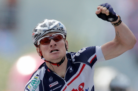 Caption: Andre Greipel of Germany crosses the finish line to win the fourth stage of the Tour de France cycling race over 214.5 kilometers (133.3 miles) with start in Abbeville and finish in Rouen, France, Wednesday July 4, 2012. (AP Photo/Laurent Rebours)