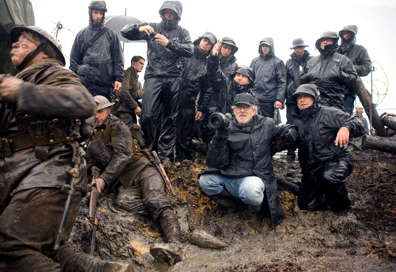 """In this film image released by Disney, director Steven Spielberg, center, is shown during the filming of """"War Horse."""" (AP Photo/Disney, Andrew Cooper)"""