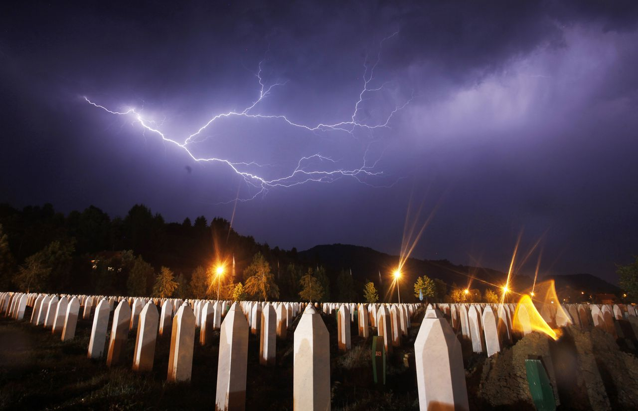 Lightning is seen during a storm under the Memorial Center in Potocari the night before a mass burial, near Srebrenica July 10, 2012. The bodies of 520 recently identified victims of the Srebrenica massacre will be buried on July 11, the anniversary of the massacre when Bosnian Serb forces commanded by Ratko Mladic slaughtered 8,000 Muslim men and boys and buried them in mass graves, in Europe's worst massacre since World War Two. REUTERS/Dado Ruvic (BOSNIA - Tags: POLITICS CONFLICT ANNIVERSARY ENVIRONMENT TPX IMAGES OF THE DAY)