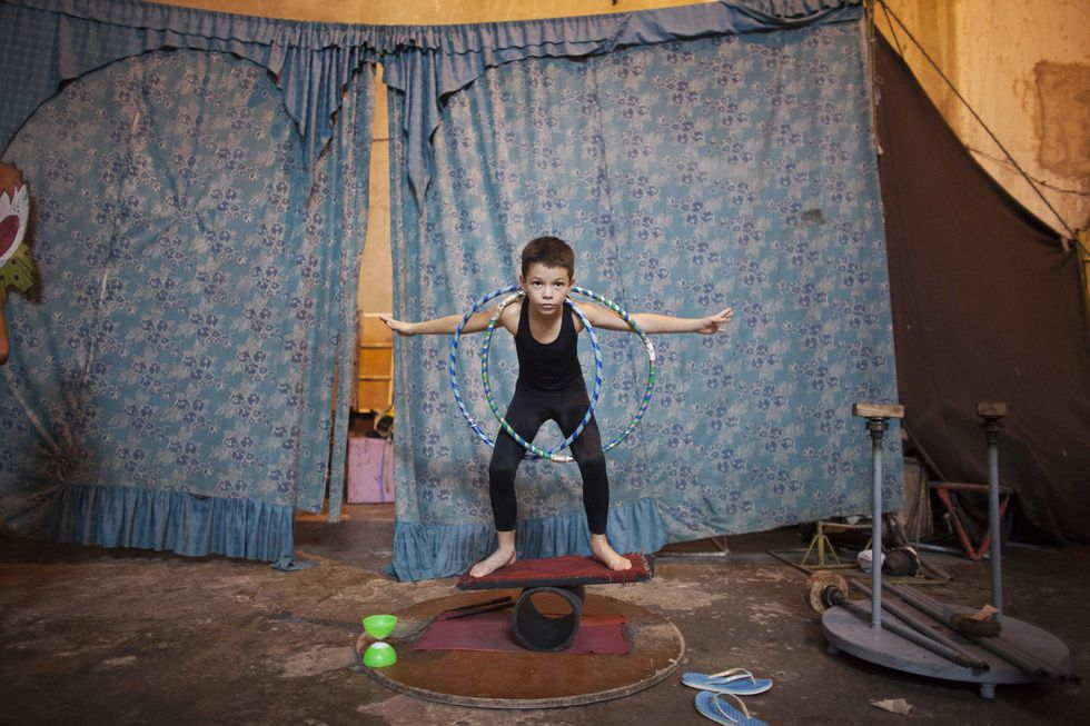 Boy practises during a training session at a circus school in Havana