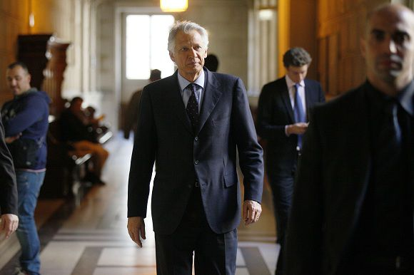 """Former French Prime minister Dominique de Villepin is pictured at the Paris courthouse during the appeal hearing of the so-called """"Clearstream affair"""", on May 11, 2011, after his opponents appealed against his acquittal on charges of slander involving President Nicolas Sarkozy in the Clearstream scandal. Villepin is suspected of orchestrating a leak in 2004 of a faked list of account holders at the Clearstream bank, which included French president Nicolas Sarkozy's name. rllepin AFP PHOTO /THOMAS SAMSON"""