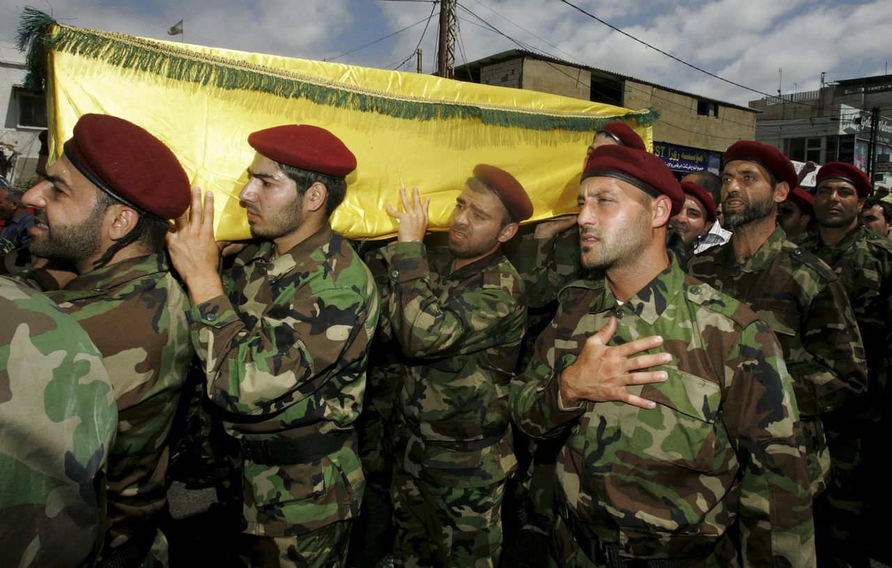 Supporters of Hezbollah and relatives of Hezbollah members attend the funeral of a Hezbollah fighter who died in the Syrian conflict in Ouzai in Beirut May 26, 2013. Hezbollah forces and Syrian President Bashar al-Assad's troops launched a fierce assault last week aimed at driving Syrian rebels out of Qusair, a strategic town close to the Lebanese border that rebels have used as a crucial supply corridor for weapons coming into Syria. REUTERS/Mostafa Assaf (LEBANON - Tags: POLITICS CONFLICT)