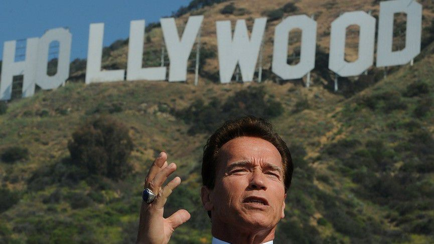 """(FILES) In a file picture taken on April 26, 2010 California Governor Arnold Schwarzenegger makes the announcement that sufficient money had been raised to purchase and protect the land around the historic Hollywood sign in Hollywood. Schwarzenegger steps down as California """"Governator"""" on January 3, defending his record to the last -- and keeping fans and others guessing about his next move. AFP PHOTO/Mark RALSTON"""