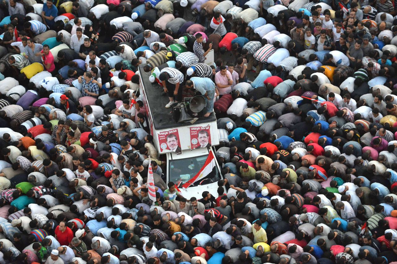 Egyptians pray as they celebrate in Cairo's Tahrir Square the victory of Muslim Brotherhood member Mohamed Morsi in the national elections, on June 24, 2012. Morsi was declared the first president of Egypt since a popular uprising ousted Hosni Mubarak, beating Mubarak-era minister Ahmed Shafiq and capping a tumultuous and divisive military-led transition. AFP PHOTO / KHALED DESOUKI