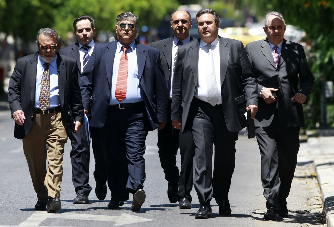 Leader of the Independent Greeks party Panos Kammenos (2nd from R) accompanied by party officials, arrives at the Presidential palace for a meeting with other political leaders and the Greek President in Athens May 15, 2012. Greece's president will ask politicians on Tuesday to stand aside and let a government of technocrats steer the nation away from bankruptcy, but leftists have already rejected the proposal and look set to force a new election they reckon they can win. REUTERS/John Kolesidis (GREECE - Tags: POLITICS ELECTIONS)