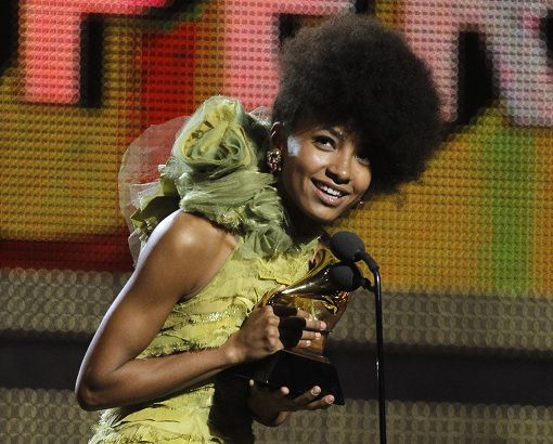 Jazz singer and bassist Esperanza Spalding accepts the award for Best New Artist at the 53rd annual Grammy Awards in Los Angeles, California February 13, 2011. REUTERS/Lucy Nicholson (UNITED STATES - Tags: ENTERTAINMENT) (GRAMMYS-SHOW)