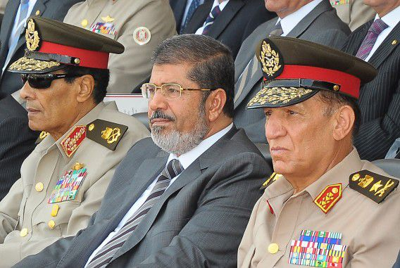"""(FILES) A handout picture released by the Egyptian presidency on July 9, 2012 shows Egyptian President Mohamed Morsi (C), head of the military council Field Marshal Mohammed Hussein Tantawi (L) and armed forces chief Sami Anan (R) attending a graduation ceremony of military cadets in Cairo. Morsi replaced Defence Minister Tantawi and sent him into retirement, official news agency MENA reported on August 12, 2012, adding that Anan was also retired. AFP PHOTO/EGYPTIAN PRESIDENCY == RESTRICTED TO EDITORIAL USE - MANDATORY CREDIT """"AFP PHOTO/EGYPTIAN PRESIDENCY"""" - NO MARKETING NO ADVERTISING CAMPAIGNS - DISTRIBUTED AS A SERVICE TO CLIENTS =="""