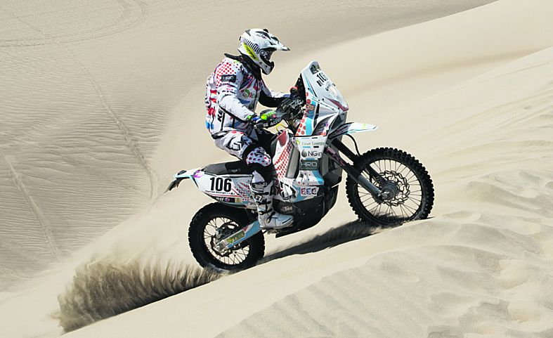 In this Jan. 6, 2013 photo, KTM rider Thomas Bourgin of France competes in the 1st stage of the 2013 Dakar Rally near Pisco, Peru. Bourgin died on Jan. 11, 2013 in an accident during the 7th stage of the Dakar Rally between Calama, Chile, and Salta, Argentina. (AP Photo/Victor R. Caivano)
