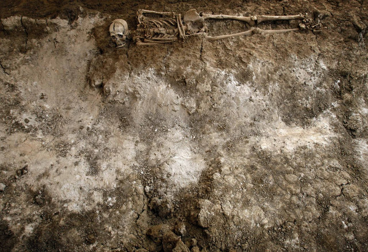 A human skeleton is seen in a mass grave in San Rafael cemetery in Malaga, Spain, Sunday, Sept. 21, 2008. At the start of the 1936-39 war, Malaga became one of many execution grounds for perceived opponents of Francisco Franco, the army general who unleashed the conflict by rising up against the elected, leftist Republican government. One of them was perhaps the war's most famous victim, Federico Garcia Lorca, widely considered Spain's best 20th century poet and playwright. Garcia Lorca, was shot along with a school teacher named Dioscoro Galindo Gonzalez and two labor union activists , Francisco Galadi and Juan Arcolla on Aug. 18, 1936 in nearby Viznar. For years, the poet's descendants blocked requests by the Galindo and Galadi families to open up the grave. Tired of waiting, Galindo and Galadi relatives took their case to crusading investigative magistrate Baltasar Garzon, who had recently begun a probe into what are essentially Spain's missing ones.(AP Photo/Sergio Torres)