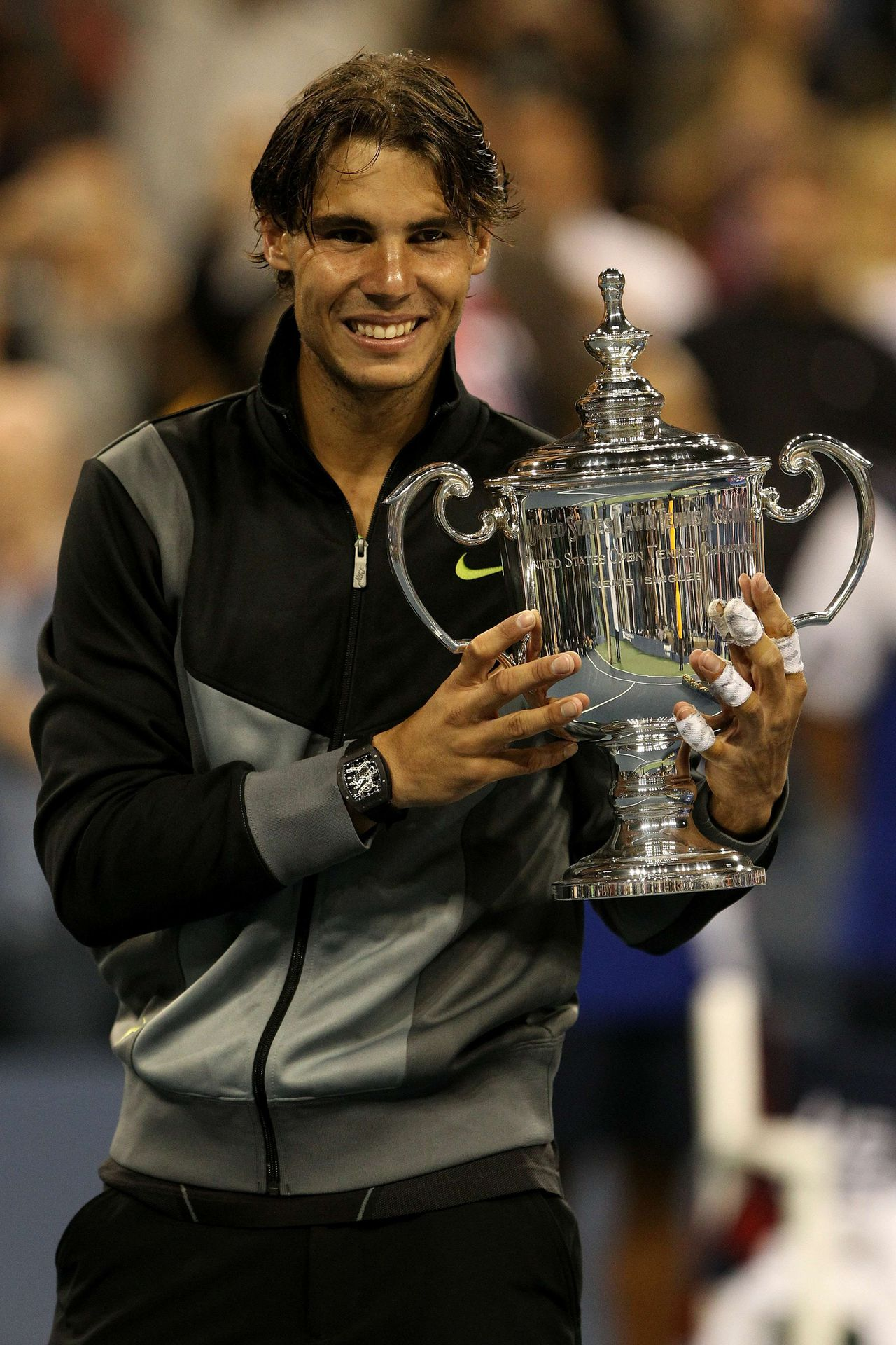 NEW YORK - SEPTEMBER 13: Rafael Nadal of Spain celebrates with the championship trophy after defeating Novak Djokovic of Serbia to win the men's singles final on day fifteen of the 2010 U.S. Open at the USTA Billie Jean King National Tennis Center on September 13, 2010 in the Flushing neighborhood of the Queens borough of New York City. Matthew Stockman/Getty Images/AFP == FOR NEWSPAPERS, INTERNET, TELCOS & TELEVISION USE ONLY ==