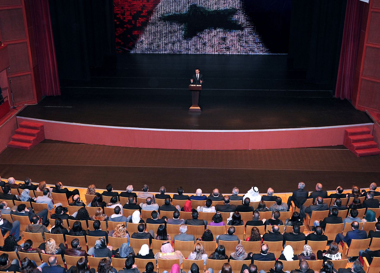 In this photo released by the Syrian official news agency SANA, Syrian President Bashar Assad, speaks at the Opera House in central Damascus, Syria, Sunday, Jan. 6, 2013. Syrian President Bashar Assad on Sunday outlined a new peace initiative that includes a national reconciliation conference and a new government and constitution but demanded regional and Western countries stop funding and arming rebels first. (AP Photo/SANA)