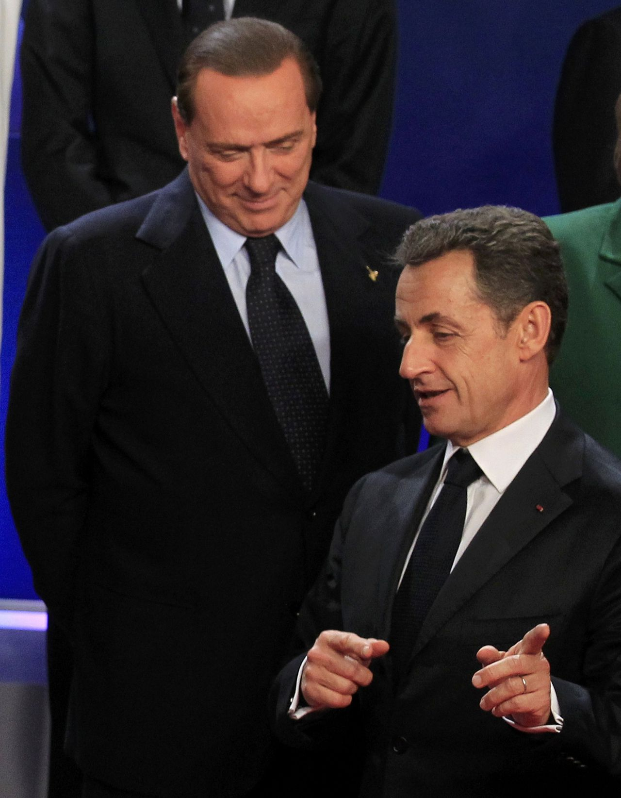 France's President Nicolas Sarkozy (R) speaks with Italy's Prime Minister Silvio Berlusconi during the traditional family photo during the G20 Summit of major world economies in Cannes November 3, 2011. REUTERS/Yves Herman (FRANCE - Tags: POLITICS)