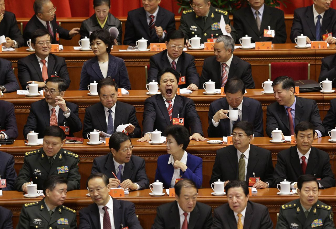 Delegates sit at the stage before the opening ceremony of 18th National Congress of the Communist Party of China at the Great Hall of the People in Beijing, November 8, 2012. China's outgoing President Hu Jintao said the nation faced risk and opportunity in equal measure as he formally opened a congress of the ruling Communist Party that will usher in a once-in-a-decade leadership change. REUTERS/Jason Lee (CHINA - Tags: POLITICS TPX IMAGES OF THE DAY)